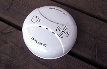 Carbon monoxide detector attached to a wall