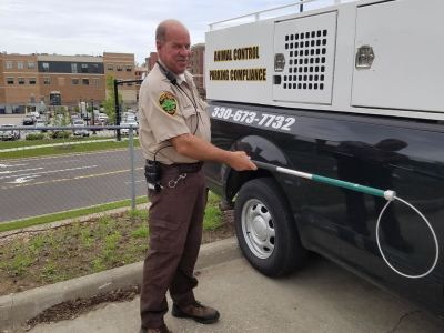 Compliance Officer Ron Gardner with Animal Control Pole